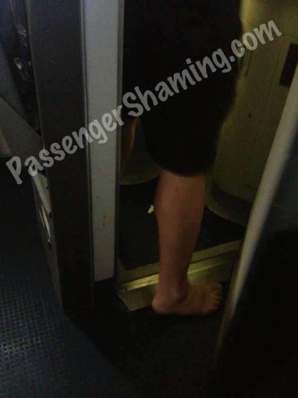 airplane bathroom no shoes