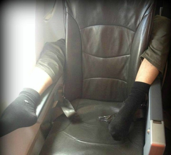 feet armrests airplane