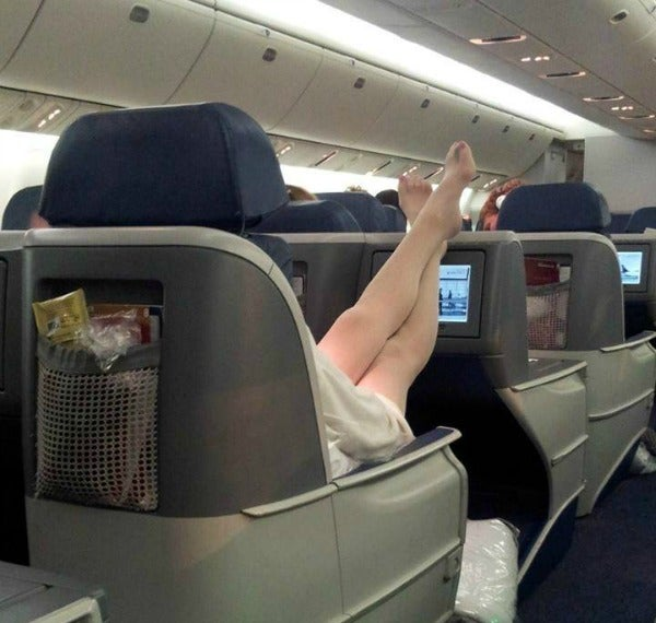 feet headrest first class
