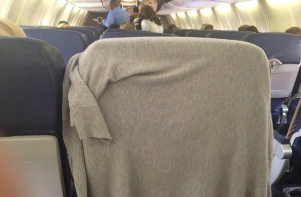 jacket covering tray table
