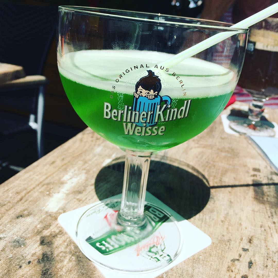 a dyed green wheat beer with a straw in berlin