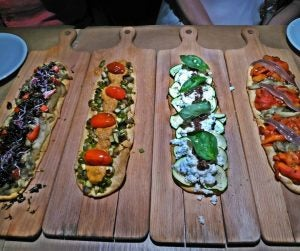 coca flatbreads with vegetables and anchovy
