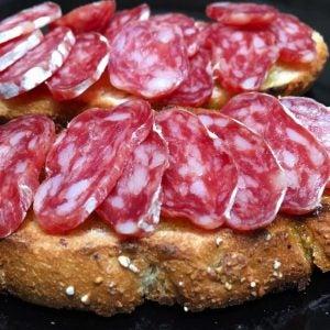 sliced fuet on bread