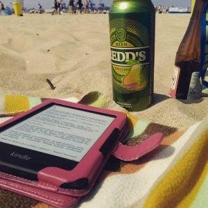 a kindle e-reader on the beach