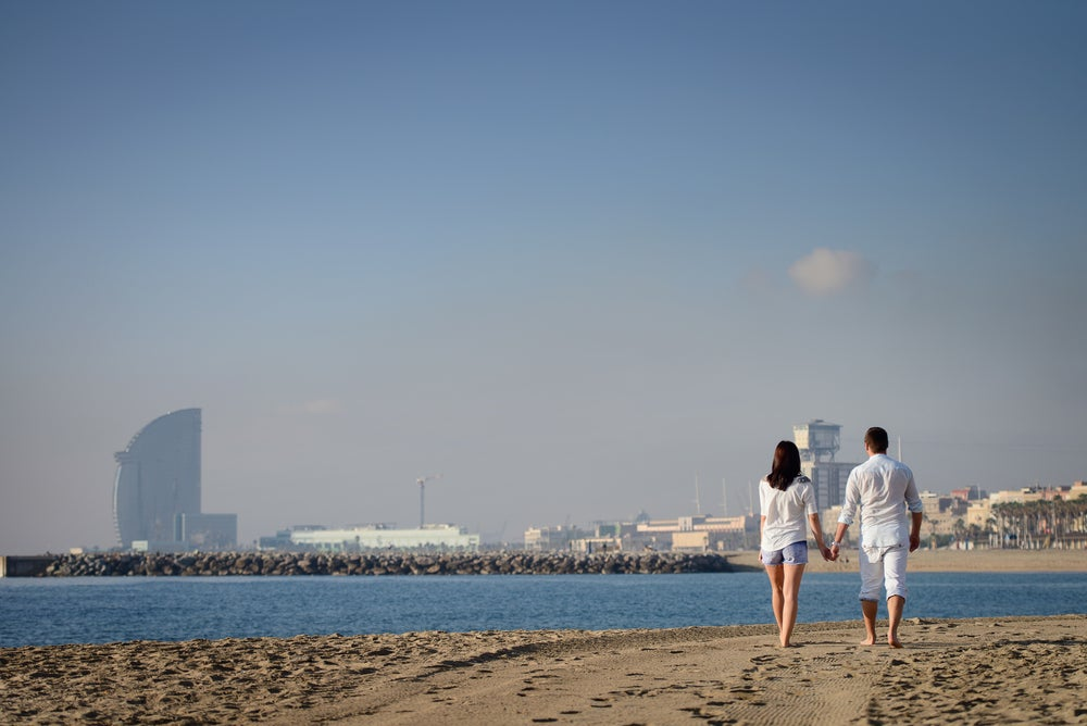 Couple at the beach in Barcelona