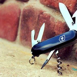 a blue swiss army knife open