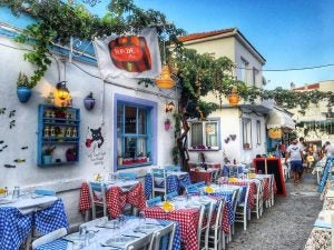 a restaurant-lined cobblestone street in bozcaada turkey