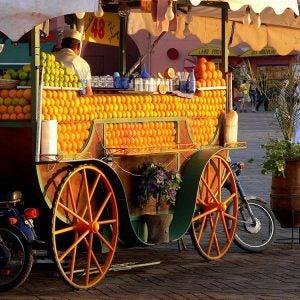an orange juice cart in marrakech