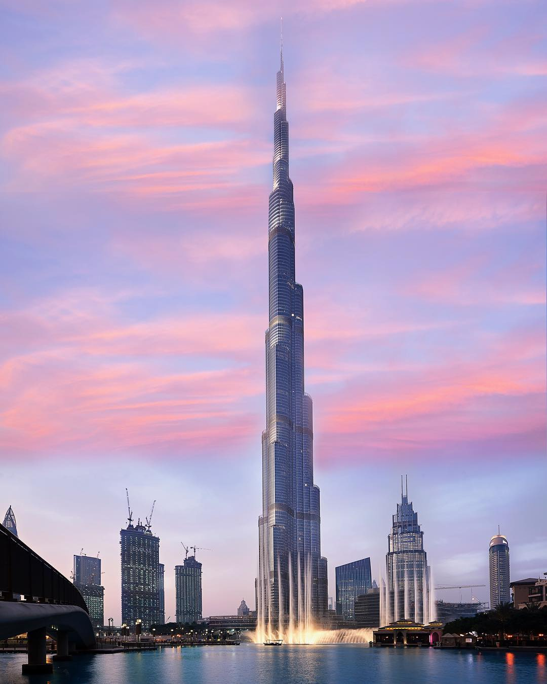 a view of the burj khalifa at dusk
