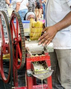 a man makes sugar cane juice in havana cuba