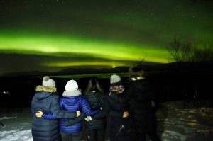 five friends watch the northern lights in january from abisko sweden