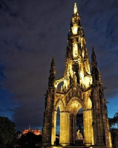 the scott monument lit up at night edinburgh scotland