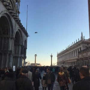 tourists walk around st marks square in venice italy