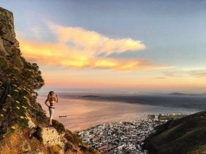 a hiker overlooks cape town from table mountain