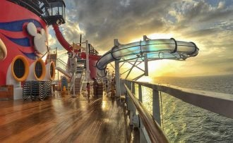 a waterslide on the top deck of a disney cruise ship