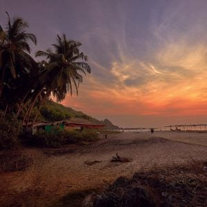 a beach shack at sunset in goa india