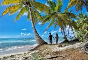 a couple holding hands on a beach at punta cana dominican republic