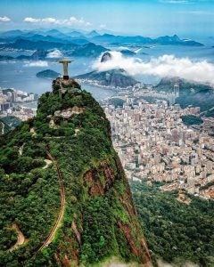 an aerial shot of rio de janeiro with christ the redeemer