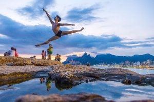 a gymnast leaps in rio de janeiro harbour