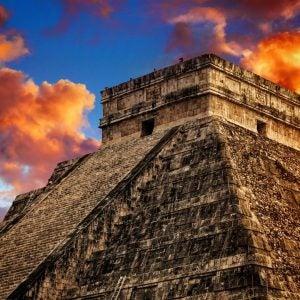 a massive step pyramid in chichen itza mexico