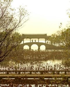 a lakeside bridge in hangzou china