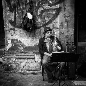 a street musician performs in the historic centre mexico city