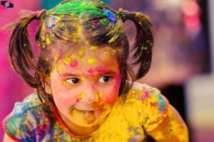 a paint covered girl during holi festival in india