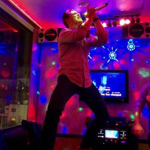 a man sings karaoke in tokyo japan