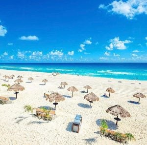 empty beach chairs and umbrellas along the mayan riviera