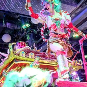 a colourful girl leads the crowd at the robot restaurant tokyo