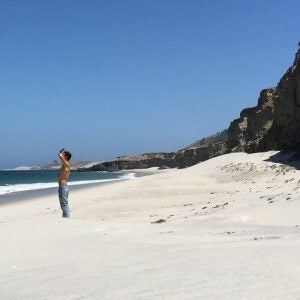 a sunbather on a white sand beach at channel islands national park california