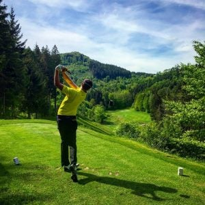 a golfer tees off at golfclub adamstal