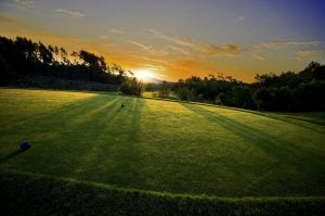 a tee box at sunset at terre blanche golf course france