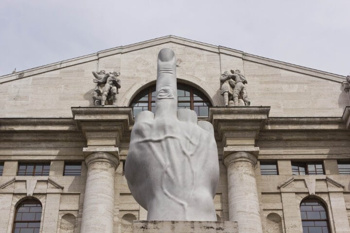 Cattelan's famous sculpture - The Middle Finger - in piazza affari - milan - italy