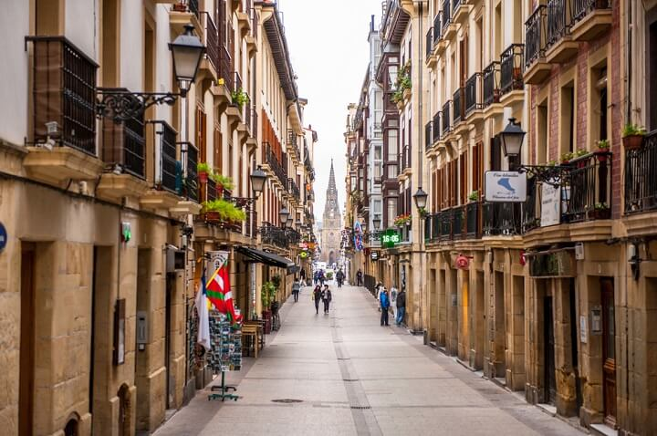 san sebastian street with church - spain