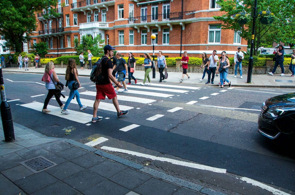 Crossing at Abbey Road with people