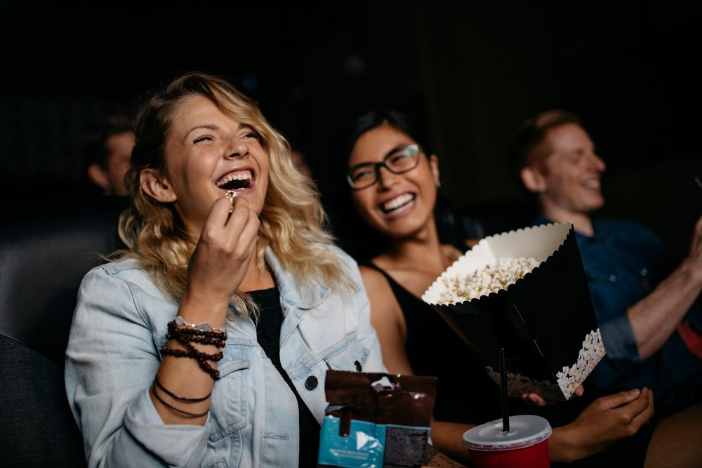 Girls laughing in the theatre