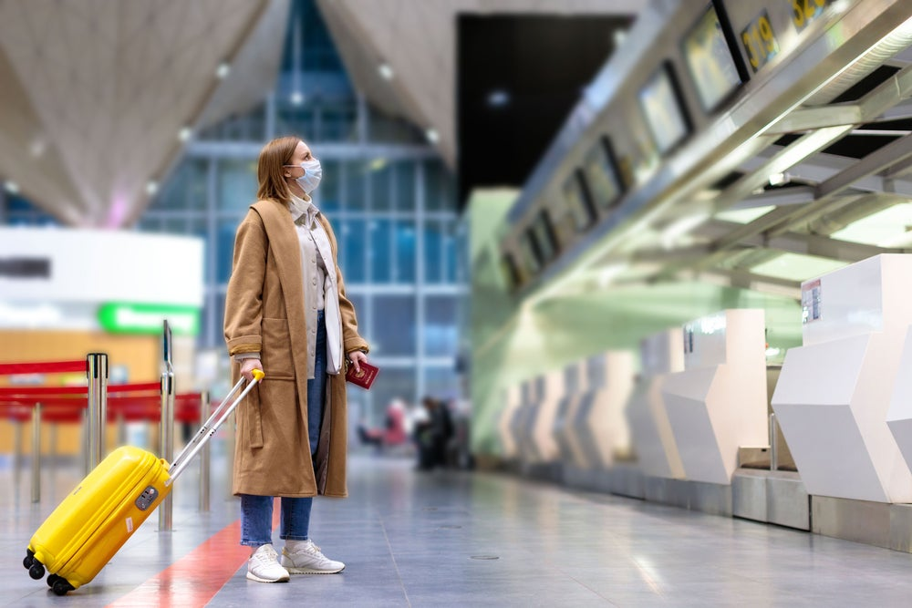 Woman in airport with mask