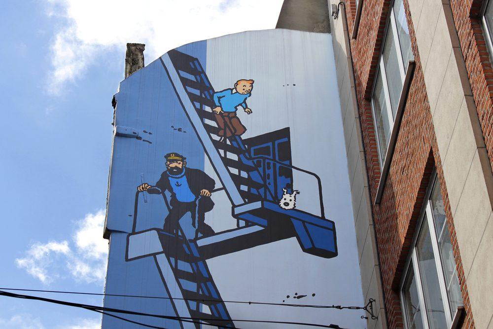 Tintin escaping down a fire escape mural