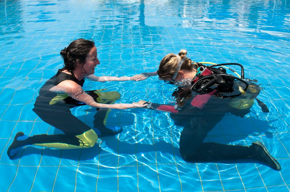 Learning to scuba dive in pool