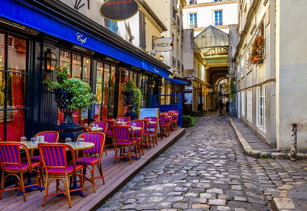 Side street with a typical cafe in Paris