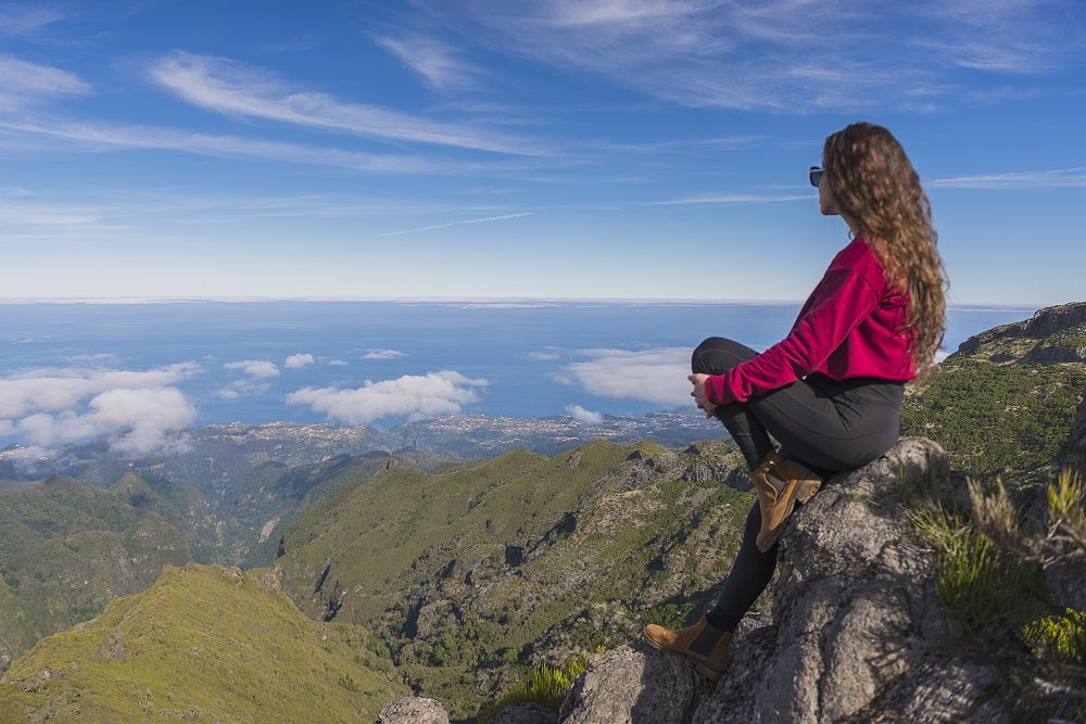 madeira, woman watching the view from mountain pico ruivo